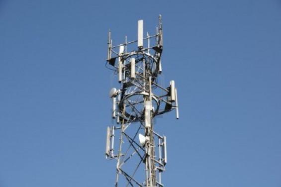 4951557 a phone mast against a clear blue sky