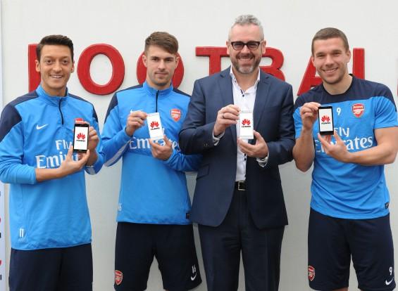 wpid Mesut Özil Aaron Ramsey Mark Mitchinson and Lukas Podolski pictured w....jpg