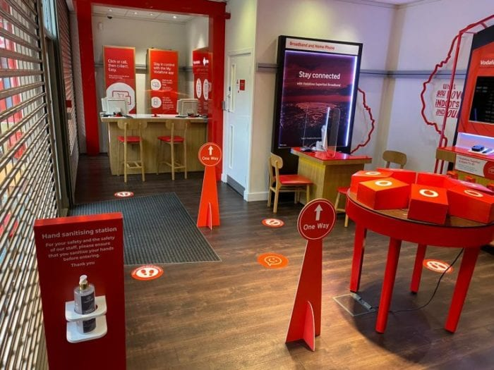 Vodafone stores reopening, but no devices on show.